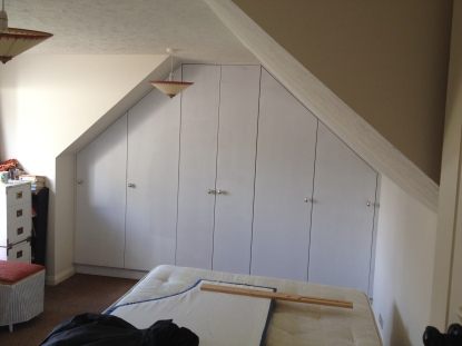 Fitted wardrobe for a home in Ashington West Sussex. This was designed to maximize storage in a loft bedroom.