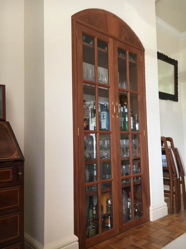 Mahogany drinks cabinet with glazed doors