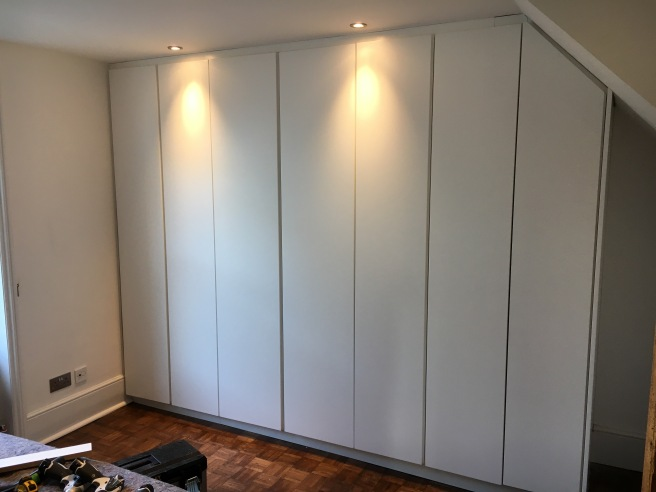 Floor to ceiling fully fitted wardrobes