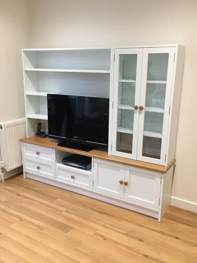 Glazed cabinet with TV shelf