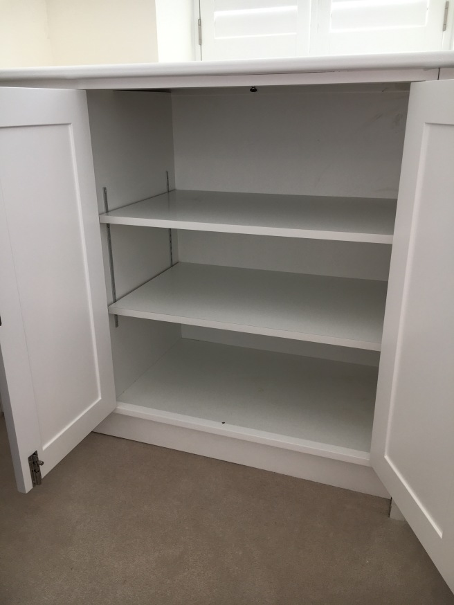 Home office cabinet with adjustable shelf