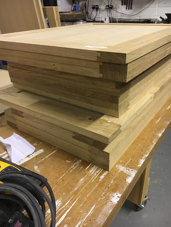 Stack of oak doors ready for finishing