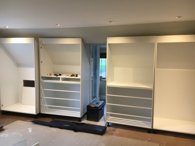 Leveling up wardrobes onsite at customers house