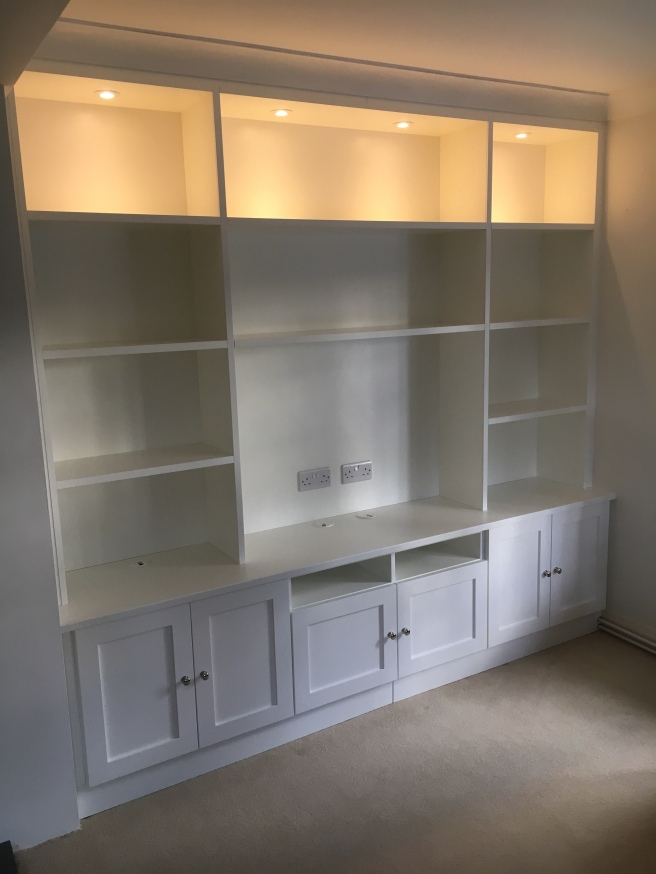 Alcove furniture with cupboards below and open shelving above