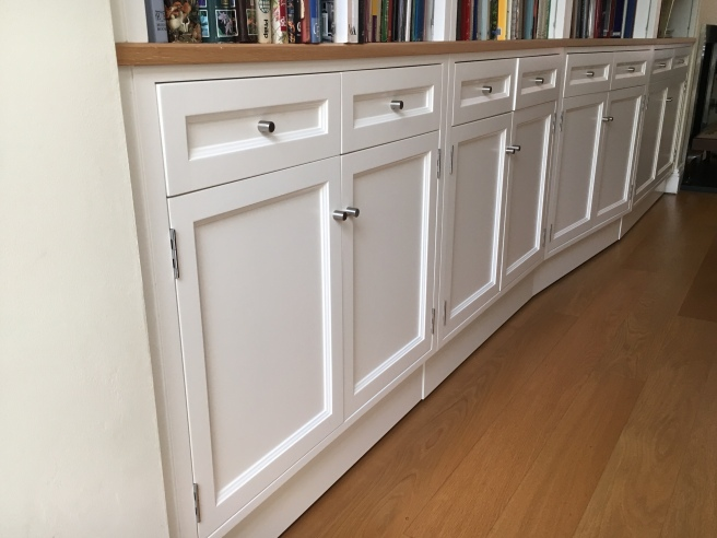 Cupboard doors and drawer fronts with chrome handles