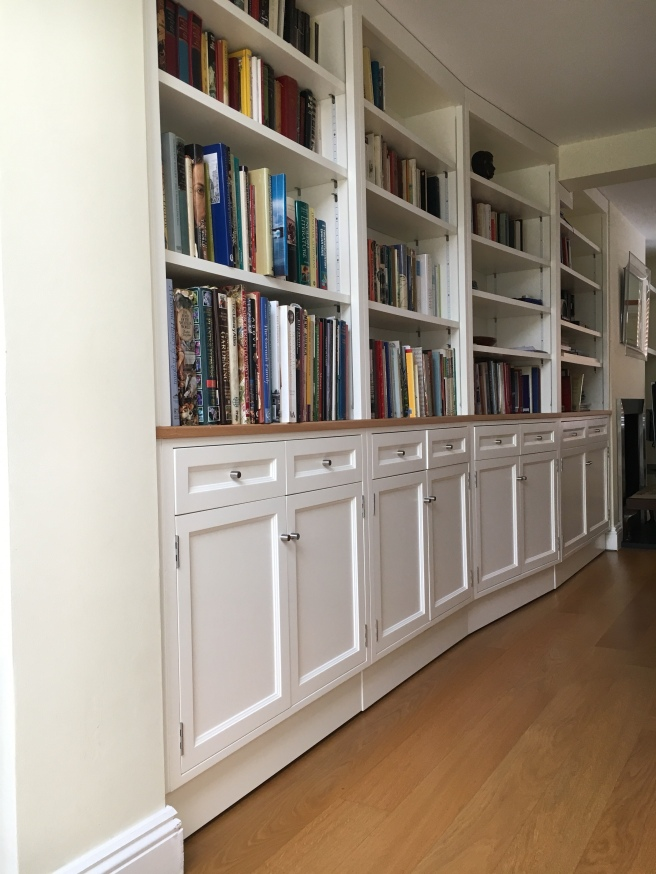 Living room shelving and storage cupboards