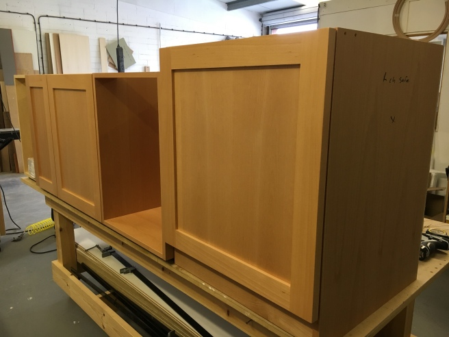 Fitting out home office cabinets prior to fitting at customers house