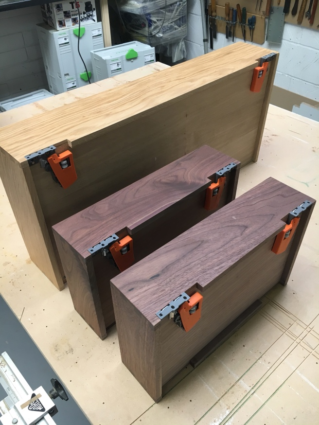 Dovetailed drawer boxes with fitted clips ready for cabinet