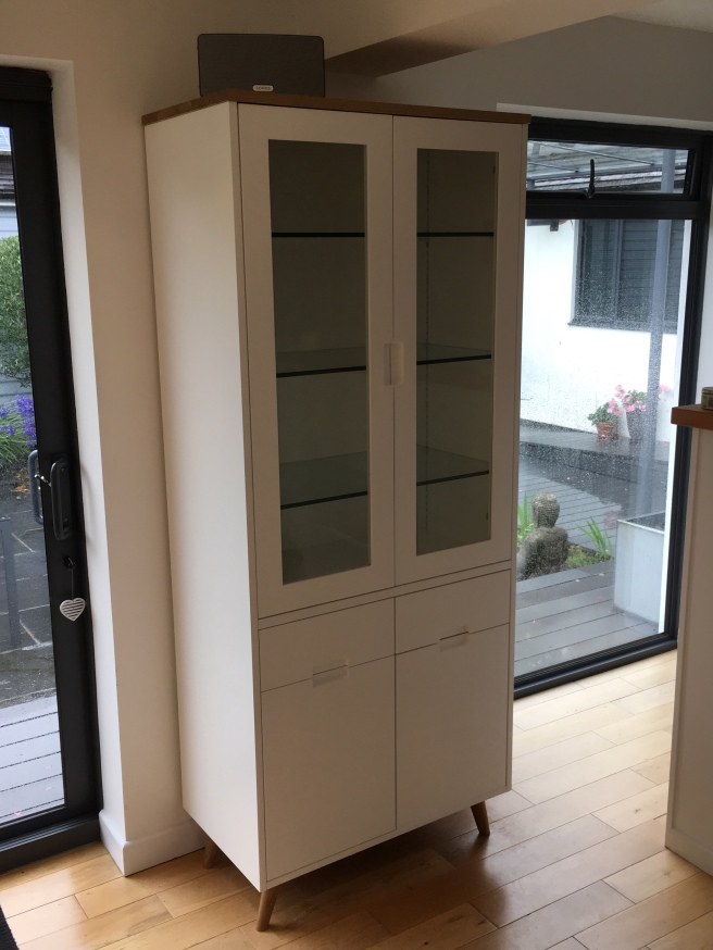 Freestanding cabinet with glazed doors